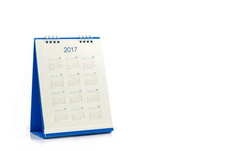 White paper desk spiral calendar 2017 on white background. Foto de archivo