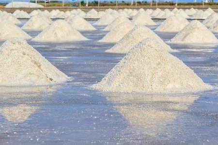 briny: Heap of sea salt in salt farm ready for harvest, south of Thailand.
