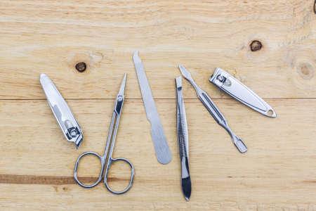 manicure set: Tools of a manicure set on wood desk background.