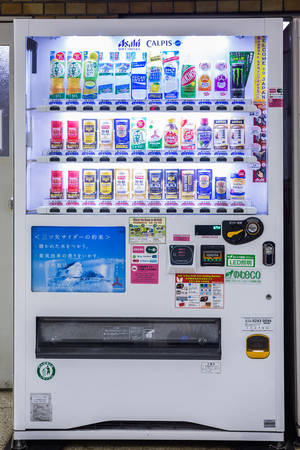 soft sell: Tokyo, Japan - April 7, 2016: Vending machines of soft drinks and water in subway station at Tokyo, Japan.