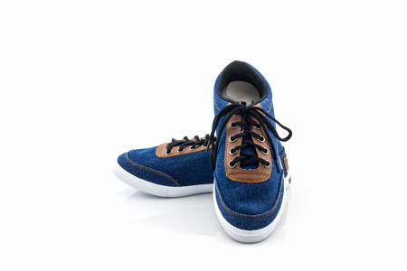 Blue sneakers on a white background. Canvas Shoe. Stock Photo
