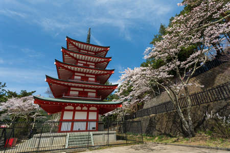 sengen: Tokyo, Japan - April 11, 2016: Chureito Pagoda in Arakura Sengen Shrine area is viewpoint of Mount Fuji in combination with cherry blossoms and autumn colors popular. Editorial