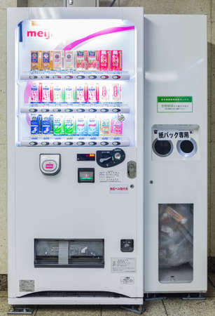 Tokyo, Japan - April 8, 2016: Vending machines of soft drinks and water in subway station at Tokyo, Japan.