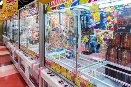 Tokyo, Japan - April 12, 2016: Toy crane game vending machine at game center in Tokyo. Japan.