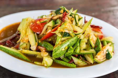 green papaya salad: Spicy cucumber salad that is one type papaya salad. Som Tum spicy thai food. Stock Photo