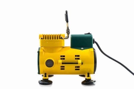 air pressure: Mini air compressor on the white background.