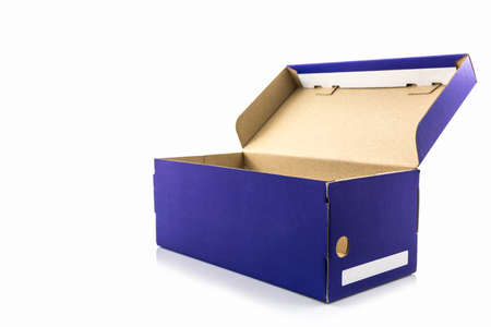 shoe box: Blue shoe box with clipping path on white background. Paper box for shoes, electronic device and other products. Stock Photo