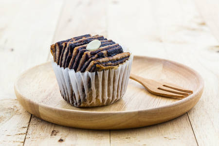 flaky: Chocolate flaky mini bread in the wooden plate on wood background.