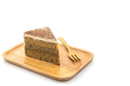 pound cake: Coffee cake slice in wooden plate on white background.