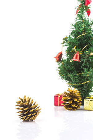 pinecones: Beautiful golden pine cone on white background for Christmas decorative. Stock Photo