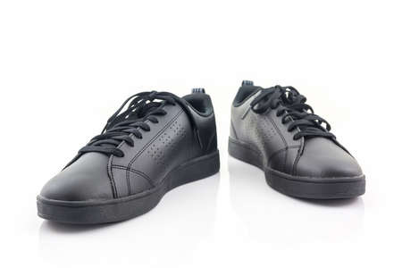 Black sneakers on a white background. Canvas Shoe. Stock Photo