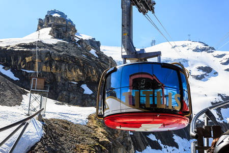 Mt. Titlis, Switzerland - May 28, 2017: a gondola of the Rotair cable car, view from the station on the top of the mountain. Rotair gondolas make a 360 degrees turn during.