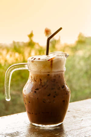Iced Chocolate drink on a wooden table.
