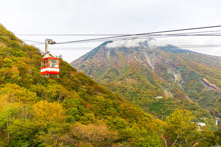 Nikko, Japan - October 16, 2018: Cable car and tourist at Akechidaira plateau in autumn at Akechidaira Ropeway Station, Nikko, Japan.