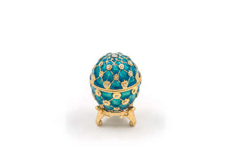 Faberge eggs on white background. Decorative ceramic easter egg for jewellery. Redakční