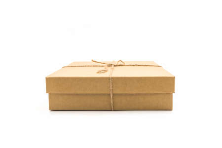 Brown paper box, tied with string on white background. Reklamní fotografie