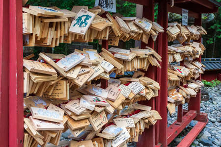 Nikko, Japan - October 15, 2018: A Japanese votive plaque(Ema) hanging in Nikko Toshogu Shrine temple, Ema are small wooden plaques used for wishes by shinto believers.