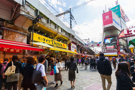 Tokyo, Japan - October 20, 2018: Tourists shopping at Ameyoko market in Tokyo Japan.It is a fresh market in the Taito Ward of Tokyo, Japan, located next to Ueno Station.