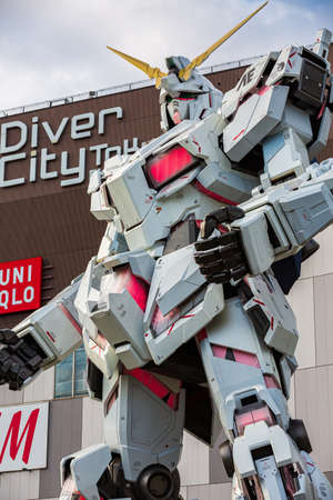 Tokyo, Japan - October 18, 2018: Full-size Mobile suit RX-0 Unicorn Gundam Performances at Diver City plaza Tokyo from Famous Anime Franchise Robot the Mobile Suit Gundam Unicorn series. Odaiba, Tokyo, Japan.