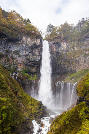 Kegon Falls one of Japans highest waterfalls in autumn at the Nikko National Park, Japan.