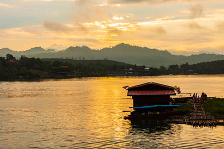 View of Songgaria river and mountain at sunset time. Sangkhlaburi, Kanchanaburi Province.