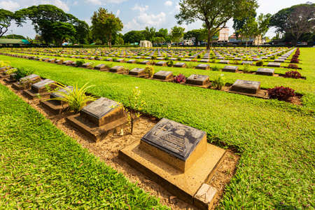 Kanchanaburi, Thailand - October 6, 2019: Kanchanaburi War Cemetery (Don Rak), Graveyard for Soldiers and Captives Allied prisoners of World War II who died during construction of the Death railway. Editoriali