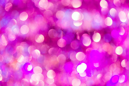 Purple and pink festive lights bokeh abstract background.