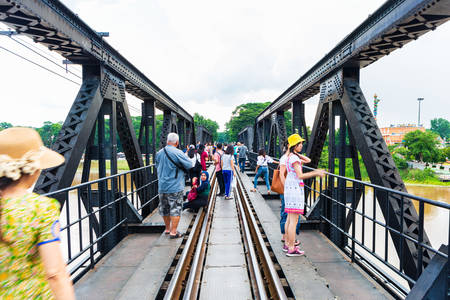Thailand, Kanchanaburi - October 6, 2019: Tourist visit The Bridge of the River Kwai is a history of world war ii, the death railway bridge over Kwai river built by Japanese soldiers, Kanchanaburi, Thailand.