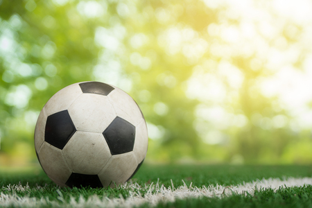 ballsport: soccer ball on soccer field and bokeh background Stock Photo