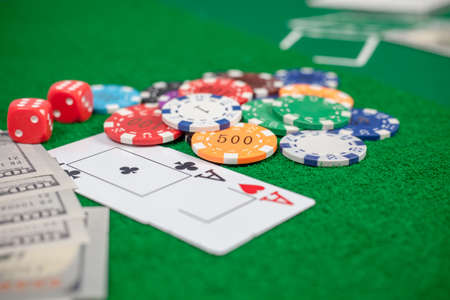 Playing cards poker chips and banknotes on table in casino Stock Photo