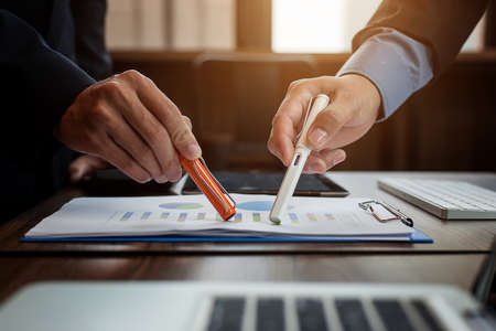 Business people meeting at working with financial reports Stock Photo