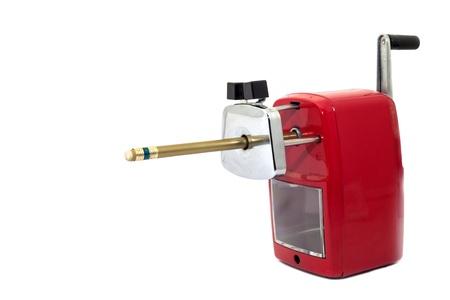 hand crank: un peque�o instrumento con una hoja interior, usado para fabricar l�pices fuerte