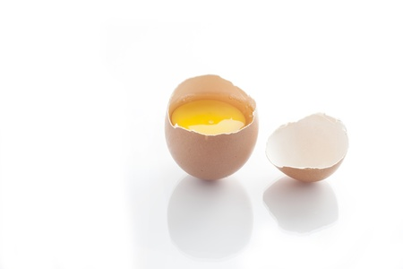 Broken egg isolated on white background Stock Photo - 19863864