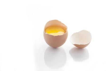 Broken egg isolated on white background Stock Photo - 19863864