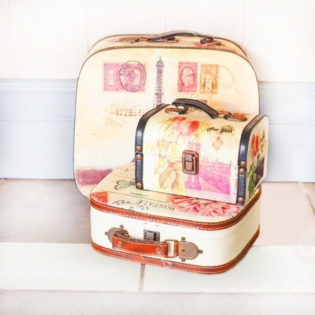 Vintage brown suitcase over white background photo