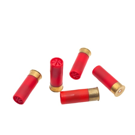 Red shotgun shell that has been fired on a white background. Stock Photo