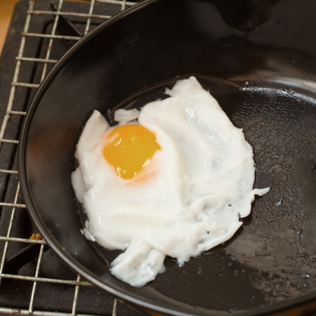 Frying  eggs with fresh water on pan photo