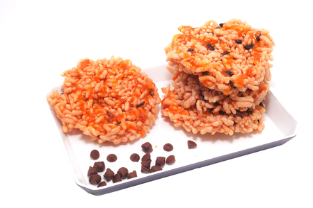 galettes: sticky rice crackers topping with Brown stew. isolated