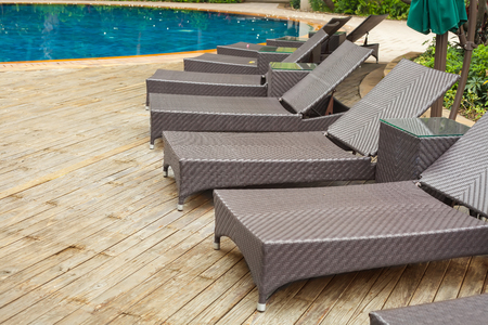 Poolside loungers at an exotic asian hotel.  photo