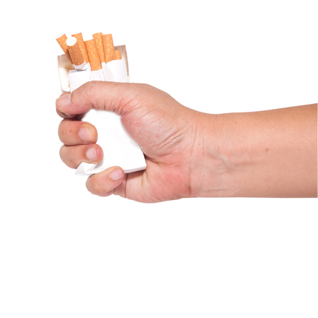 give up smoking fist and crushed pack of cigarettes photo