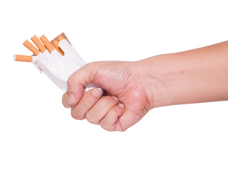 pernicious habit: give up smoking fist and crushed pack of cigarettes