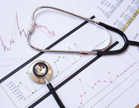Stethoscope and chart document background Stock Photo