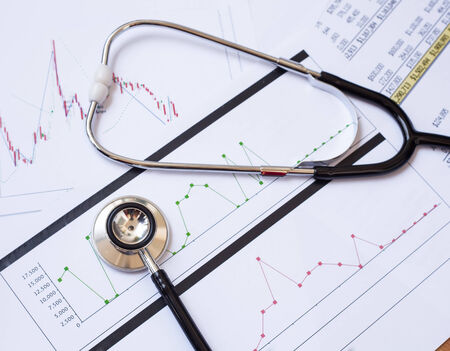 Stethoscope and chart document background Stock Photo