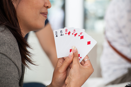 woman play card with friend Stock Photo