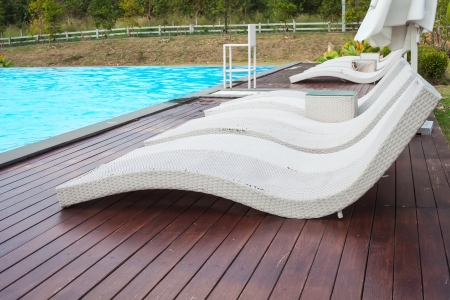 Poolside loungers at an exotic photo