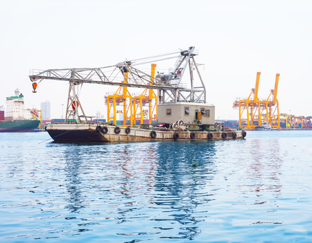 Heavy lifting floating crane vessel during operation. Stock Photo