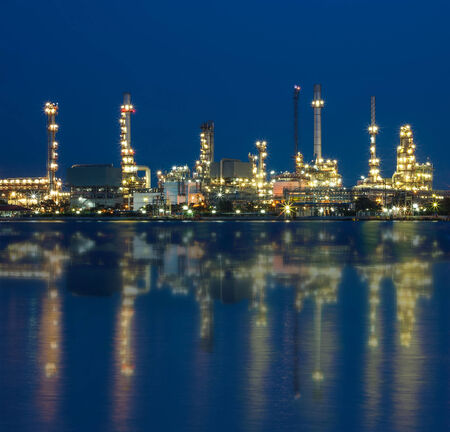 Oil refinery plant against at night