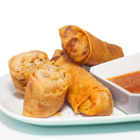 dim sum: Fried Chinese traditional spring rolls food with sweet chili dip sauce.