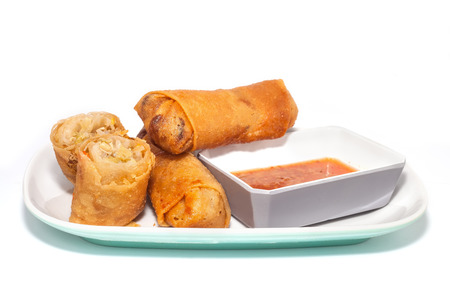 Fried Chinese traditional spring rolls food with sweet chili dip sauce.  photo