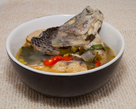striped snake head fish: thai food  tilapia fish hot and sour soup Stock Photo